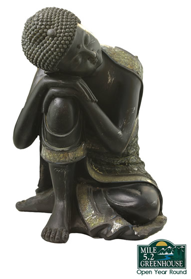 A ceramic Buddha statue in a black finish.
