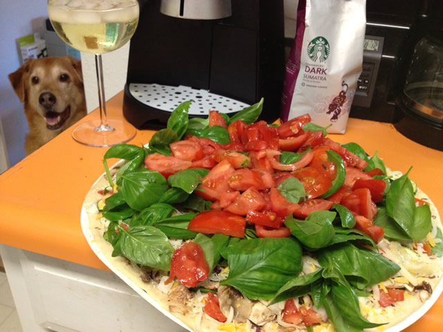 Fresh Basil and Tomatoes grown at the greenhouse used for the most delicious Pizza.